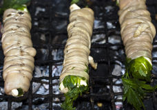 Stigghiole. Street food in Palermo. Stigghiole -typical street food in Palermo.  lamb, goat or pork bowels flavored with onions and parsley and grilled over Stock Photos