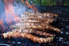 Stigghiole -typical street food in Palermo. Lamb, goat or pork bowels flavored with onions and parsley and grilled over coals Royalty Free Stock Images