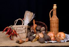 Stiil life. Still life with vegetables and wicker bowls on sack Stock Image