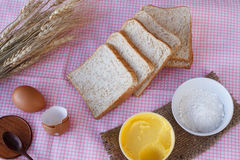 Stiil life with whole wheat bread,egg,magarine,flour and wheat o Royalty Free Stock Image