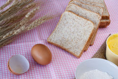 Stiil life with whole wheat bread,egg,magarine,flour and wheat o Royalty Free Stock Photos