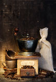 Stiill life with Antique coffee grinder royalty free stock photography