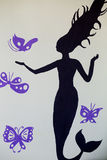 Stiker witkh woman and buterflys on the wall Stock Images