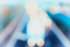 Stile astratto - luci blu Defocused della strada principale Immagine Stock