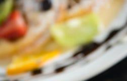 Stile offuscante Kiwi Fruity Waffle Dessert Background per progettazione immagini stock libere da diritti