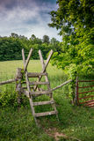 Stile over a fence along the Appalachian Trail. A wooden stile helps hikers traverse a barbed wire fence guarding farmland along the Appalachian Trail stock images