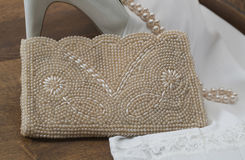 Stiletto, purse and pearls Royalty Free Stock Photo