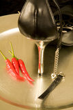 Stiletto on silver tray with chillies Stock Photography