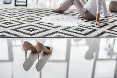 Stilettos and senior businesswoman working with documents on floor Stock Photos