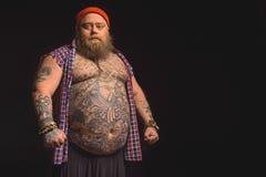 Stilfull fet man med den stora buken Fotografering för Bildbyråer