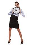 Stilfull kvinna med en rund klocka i händer Arkivfoto