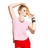 Stilfull modellflicka för tonårs- mode som isoleras på vit Fotografering för Bildbyråer