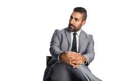 Stilig affärsman i grå färger Arkivbild