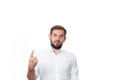 Stilig affärsman med fingerpunkt upp Arkivfoton