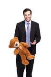 Stilig affärsman med nallebjörnen arkivfoton