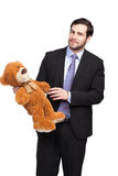 Stilig affärsman med nallebjörnen fotografering för bildbyråer