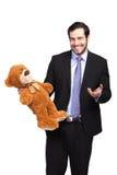 Stilig affärsman med nallebjörnen royaltyfri foto