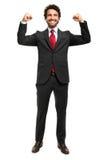 Stilig chef som lyfter armar i tecken av segern Arkivfoton