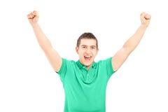 Stilig grabb som gör en gest lycka Arkivfoto