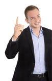 Stilig lycklig isolerad ung affärsman som upp lyfter hans finger Royaltyfri Foto