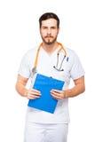 Stilig manlig doktor med den isolerade skrivplattan fotografering för bildbyråer