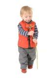Stilig pojke med röda gerberas för mamma royaltyfri foto