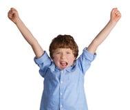 Stilig pojke som firar seger Royaltyfri Foto