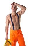 Stilig ung byggnadsarbetare med den nakna torson Royaltyfri Fotografi