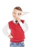 Stilig ung pojke för stående med en triangellinjal på den vita studien Fotografering för Bildbyråer