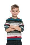 Stiliga unga pojkeställningar royaltyfri foto