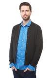 Stiligt anseende för ung man på isolerad vit bakgrund fotografering för bildbyråer