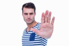 Stiligt tecken för hipstervisningstopp med handen royaltyfri bild