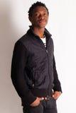 Stiligt ungt posera för svart grabb arkivbild