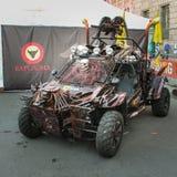 Stiliserad barnvagn på utställningen Fotografering för Bildbyråer