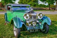 Stiliserad grön tappning Rolls Royce Fotografering för Bildbyråer
