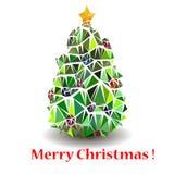 Stiliserad julgran med den gula stjärnan. Arkivfoto