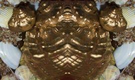 Stiliserade fugor för fisk för metallsouvenir guld- Arkivfoton
