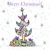 Stiliserade julgran och gåvor. Arkivbild