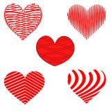Stiliserade röda och vita hjärtamodeller Royaltyfri Foto