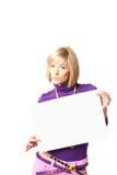 Stilish girl. Holding a blank sign Royalty Free Stock Photography