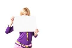 Stilish girl. Holding a blank sign Royalty Free Stock Images