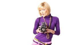 Stilish girl holding retro camera. Portrait of a stilish girl clicking camera smiling Royalty Free Stock Image