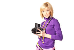 Stilish girl holding retro camera Stock Images
