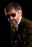 Stilish man. Portrait of middle aged man on a black background Stock Images