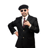 Stilish man. In beret and in sunglasses holding cigar Royalty Free Stock Photos