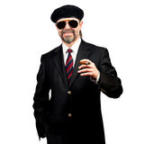 Stilish man. In beret and in sunglasses holding cigar Royalty Free Stock Photography