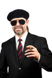 Stilish man. In beret and in sunglasses holding cigar Royalty Free Stock Image