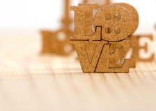 Stilisiertes Bild der Aufschrift der Liebe als Symbol der Liebe und der Hingabe lizenzfreies stockbild