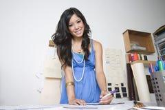 Stilista femminile At Desk Fotografia Stock
