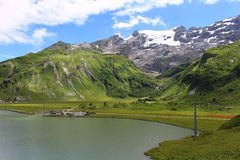 Still Alpine Lake. Trübsee, a lake above Engelberg in the foot of Mount Titlis Royalty Free Stock Photography
